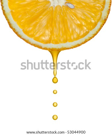 Drops of juice falling of the succulent orange - stock photo