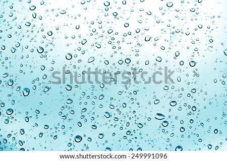 Drops of rain on glass - stock photo