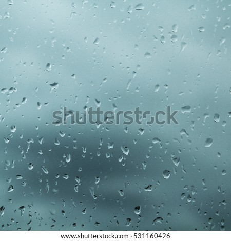 Drops of rain on the glass window