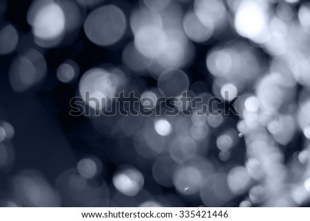 Drops of water defocused blurred fly in the air, copy space - stock photo