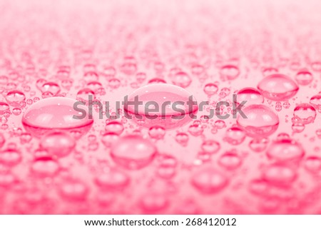 Drops of water on a color background. Pink. Shallow depth of field. Selective focus.