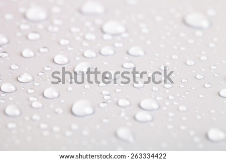 Drops of water on a color background. Shallow depth of field. - stock photo
