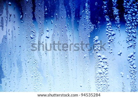 drops of water on a window glass - stock photo
