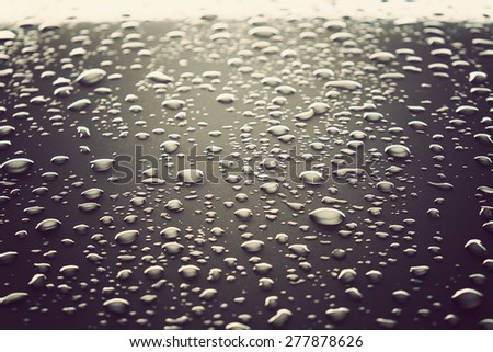 drops of water on the car after rain. vintage tone - stock photo