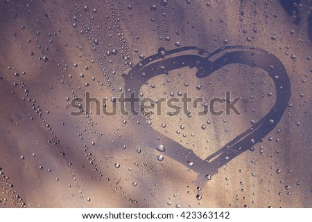 Drops pink waters on glass,heart - stock photo