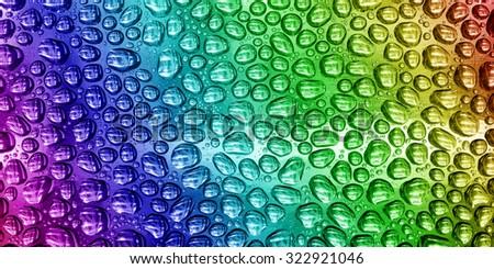 Drops rainbow background. - stock photo