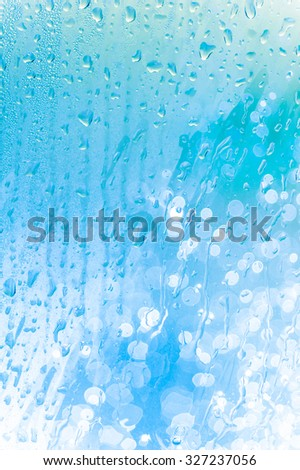 Drops water on the clear glass background - stock photo