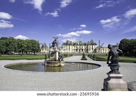 Drottningholm royal palace gardens, Stockholm, Sweden. Taken on a sunny day with water fountain in foreground. - stock photo
