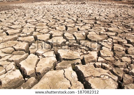 Drought breaks ground fissures of the ground. - stock photo
