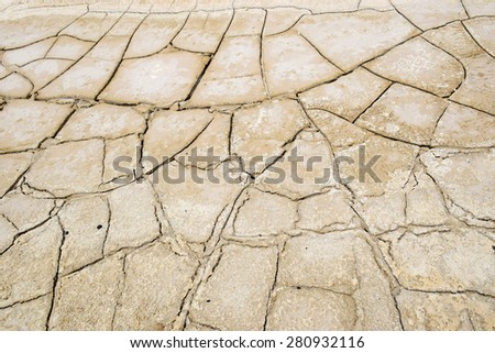 drought, dry and cracked land with salt deposits - stock photo