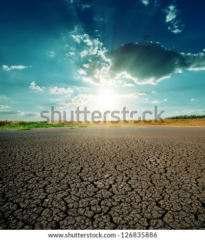drought land and dramatic sunset - stock photo