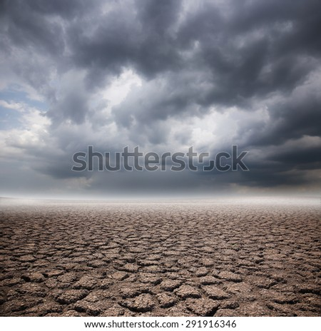 Drought land on storm cloud background - stock photo