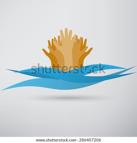 Drowning and reaching out hand for help - stock photo