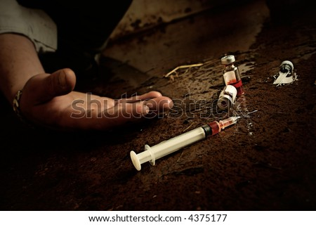 Drug abuse concept. Grunge look, slight grain added. Low key. - stock photo