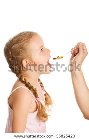 Drug abuse - little girl taking lots of medicine with spoon, isolated - stock photo