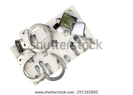 Drug bust arrest with handcuffs, fingerprint ID, and fake sample evidence. - stock photo