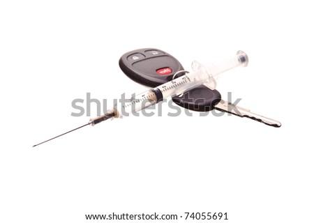 drug needle and car keys - stock photo