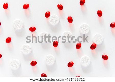 Drug prescription for treatment medication. Pharmaceutical medicament, cure in container for health. Pharmacy theme, Heap of red  white round capsule pills with medicine antibiotic in packages. - stock photo