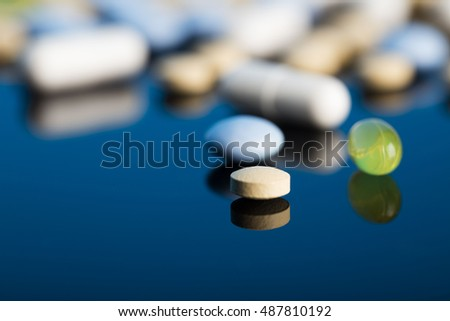 Drug prescription for treatment medication. Pharmaceutical medicament, cure in container for health. Pharmacy theme, Heap of red orange white round capsule pills with medicine antibiotic in packages.