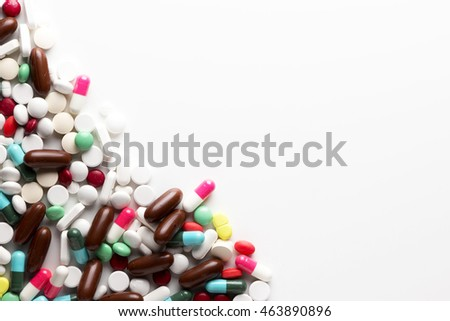 Drug Treatments and Medications in a Pile Group of Pills and Vitamins