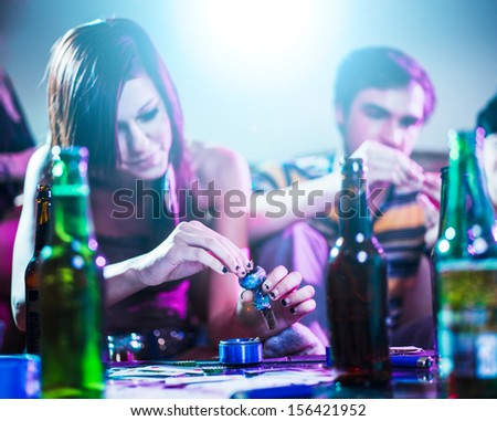 drug using teens at house party. - stock photo