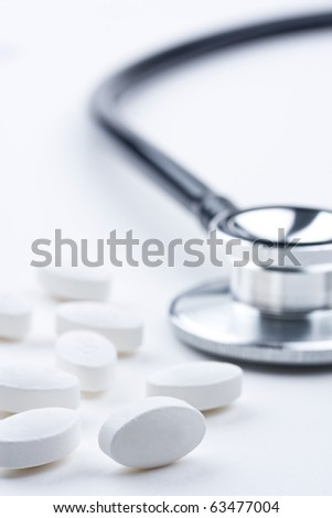 Drugs and doctor's stethoscope. Concept of medical or healthcare.