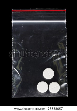 drugs in package on black background - stock photo