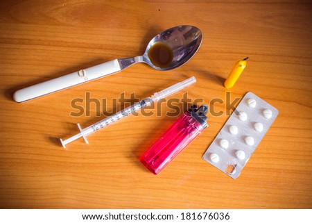 drugs syringe and spoon and lighters and candle  - stock photo