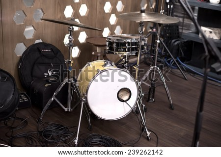 Drum kit in the wooden room - stock photo
