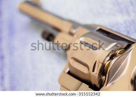 drum of revolver loaded cartridges, close up. Shallow depth of field - stock photo