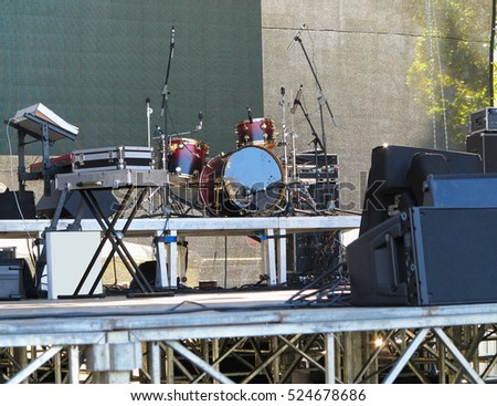 Drum set, microphones and speakers on stage ready for concert