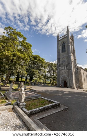 DRUMCLIFF, IRELAND - JULY 28, 2013: Graveyard with tombstone of William Butler Yeats in the shadow of rural church with famous epitaph : Cast a cold Eye On Life, on Death. Horseman, pass by!