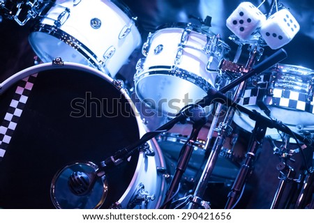 drumkit on stage under blue spotlights - stock photo