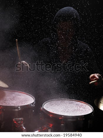 drummer in night club. Waster splash and discotheque fog - stock photo