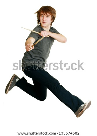 drummer man jumping in the air with drumsticks isolated - stock photo