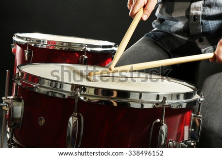 Drummer playing the drums closeup - stock photo
