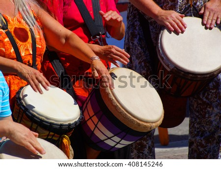 Drummers playing at a Saturday market,  Penticton, British Columbia, Canada.. - stock photo