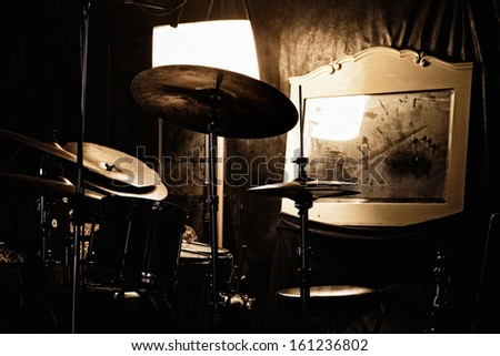 Drums, mirror and lamp - Detail of a music rehearsal room - stock photo
