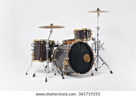 Drums of 7 elements of cinnamon and black with gold-plated fittings , photographed on a white background - stock photo