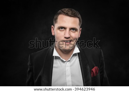 Drunk angry man on a dark background. - stock photo