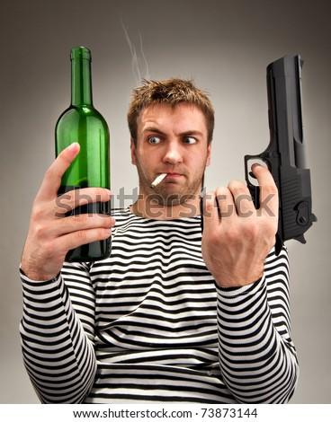Drunk bizarre sailor choosing between bottle and gun - stock photo