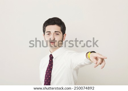 Drunk businessman pointing out - stock photo