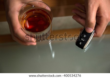 Drunk driving - the cause of car accidents. Drink. Keys - stock photo
