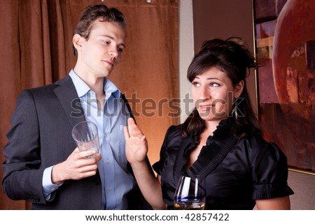 Drunk guy hits on beautiful woman - stock photo