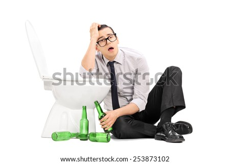 Drunk guy leaning on a toilet seat isolated on white background - stock photo