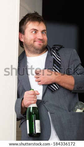Drunk guy with a bottle - stock photo