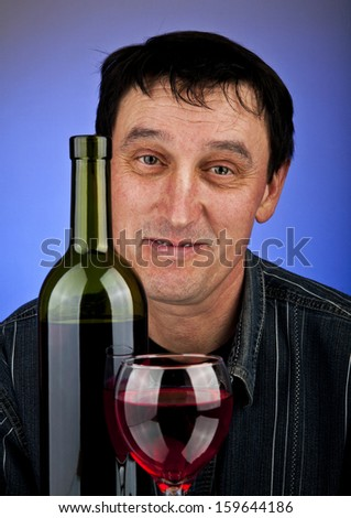 drunk man on a dark blue background - stock photo