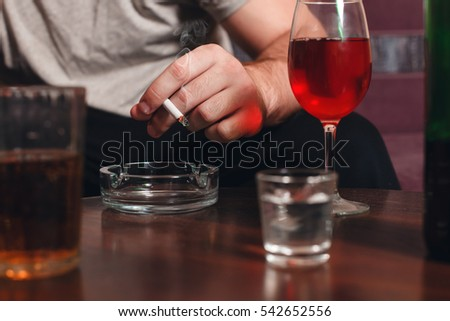 Drunk man with cigarette in hand.