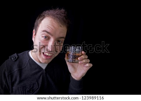 drunk man with glass of whiskey on black background with copy space