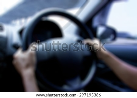 Drunk not driving concept : blurry of hand drive the car - stock photo